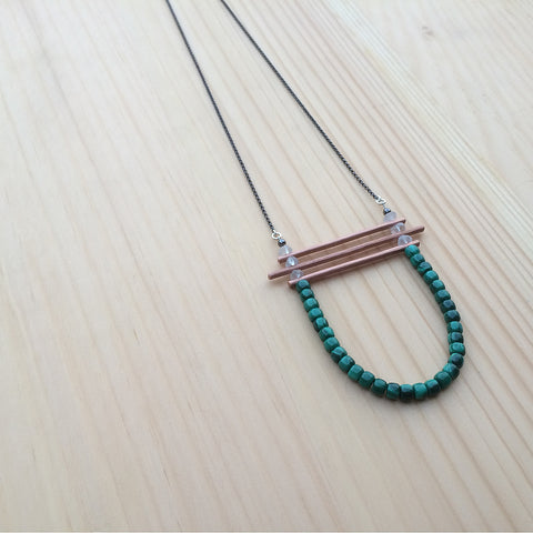 the Kirsten necklace in malachite and quartz beads with copper bars