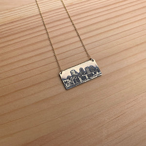 brass pittsburgh skyline pendant with gold filled chain handmade jaci riley jewelry