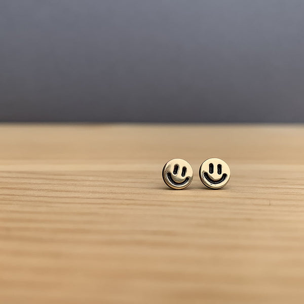 gold smiley face earrings  jaci riley jewelry