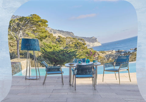 Blue chairs by pool
