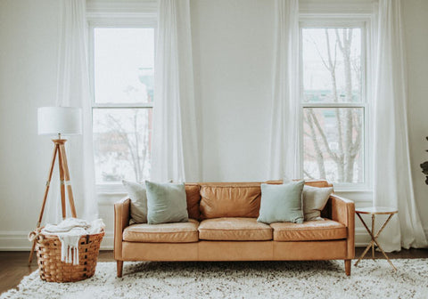 Living room with couch and accent pillows and lamps