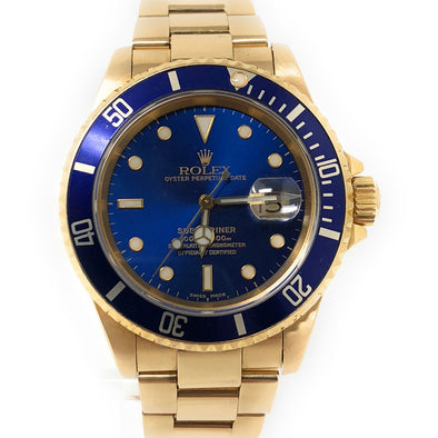 ROLEX SUBMARINER YELLOW GOLD 116618 BL - The Jewels of Beverly Hills