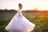 Flower girl dress in ivory satin and blush tulle.