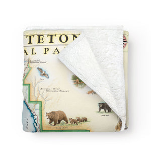 Folded, cozy blanket picturing map of Grand Teton National Park. Full color.