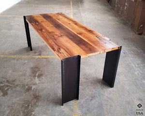 Handmade American reclaimed pine dining table with steel legs. Modern, industrial, sleek, minimalist design. Wood and metal dining room table.