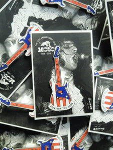 metal guitar pin in red, white and blue hard enamel with a black and white photo card back
