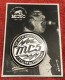MC5 chrome and black hard enamel pin WITH lightening bolts on photo background