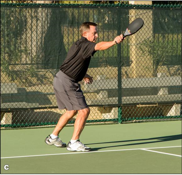 Figure 4.5 The backhand serve: () preparation, () contact, and () follow-through.