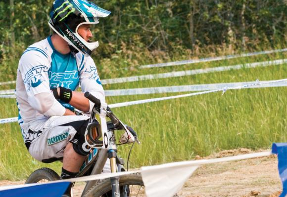 Before their race, some riders get excited and talkative. Others get quiet and reflective. Downhill, slalom, 4x, BMX, and enduro legend Jared Graves does the latter.