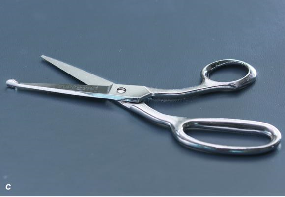 Figure 1.23 Cast saw, cast spreader, and bandage scissors that are necessary for cast removal.