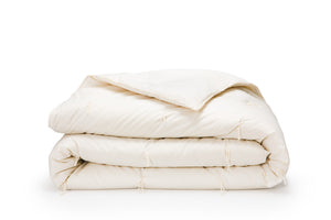 Wool comforter on white background