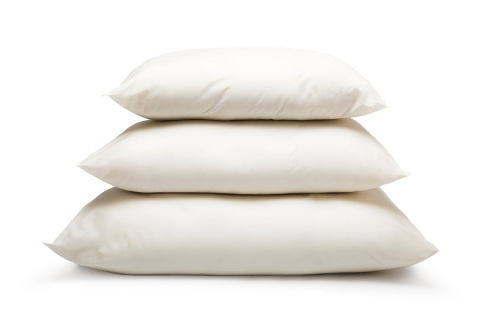 wool pillows in three sizes stacked