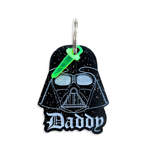 Darth Vador shaped Dog Tag, with back personlization and light sabor mini charm, says Daddy on the front of the tag.