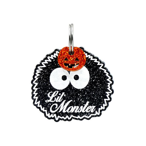 lil' Monster halloween dog tag on black glitter with orange glitter pumpkin charm