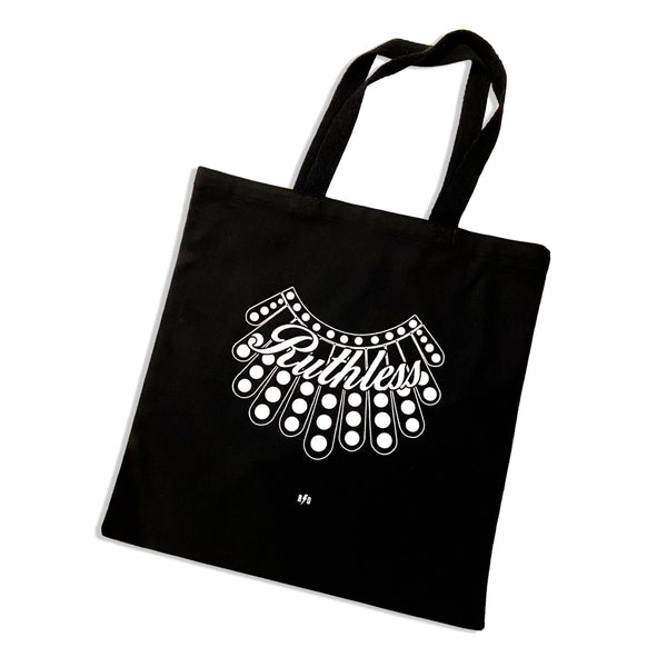 Ruthless and RBG collar printed on a black canvas tote bag.