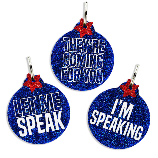Let me speak, They're Coming for you, or I'm speaking dog tags on blue glitter with red glitter stars.