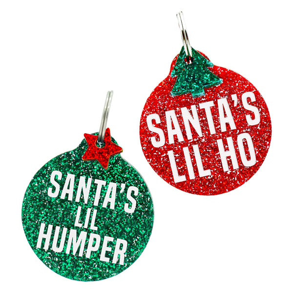 Christmas dog tags, two options, santa's lil humper in green glitter and santa's lil ho in red glitter with free mini charm.