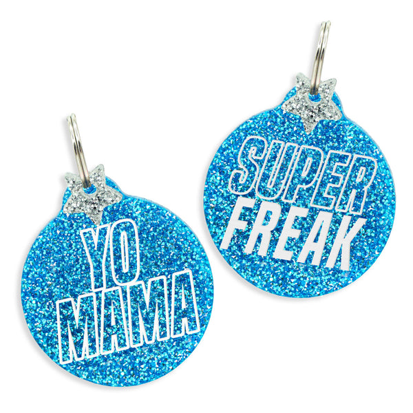 Choose from the Yo Mama dog tag in ice blue glitter with star charm or the Super Freak dog tag in ice blue glitter with star charm.