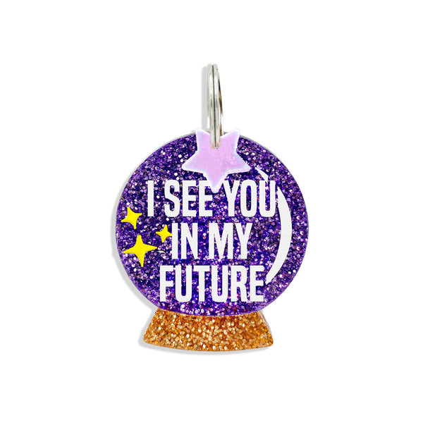 Purple glitter crystal ball tag that says, I see you in my future with a star mini charm.