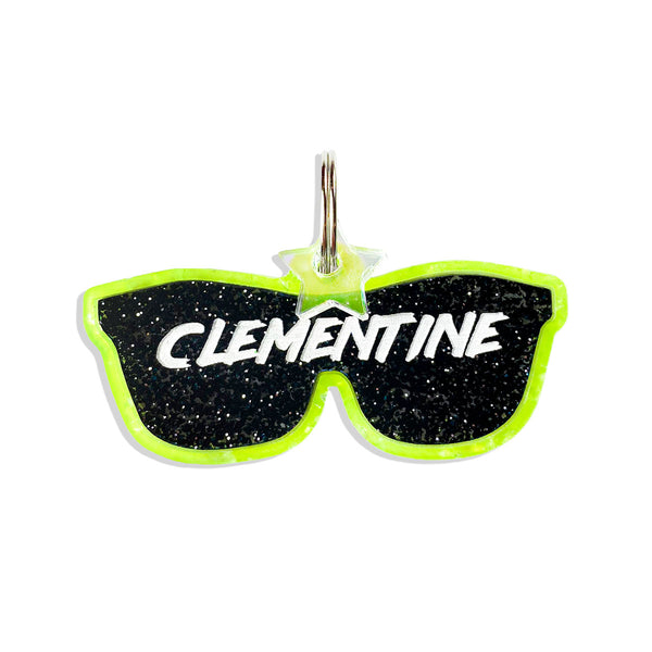 Black glitter sunglasses dog ID tag, with neon glitter outline.  Comes with free  star mini charm and free personalization.