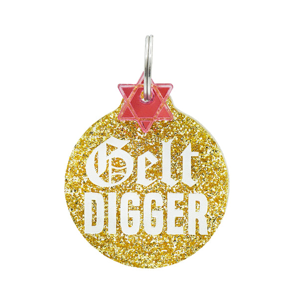 Gelt digger dog tag in gold glitter with star of david mini charm.