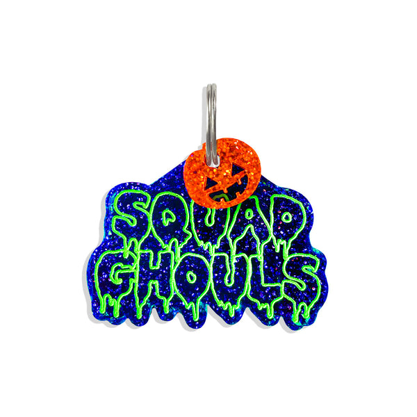 EEEk!, Squad Ghouls, To Ghoul For You! Neon Green slim drip text, orange glitter mini charms, and black purple glitter dog id tags. super cool and spooky!  Edit alt text