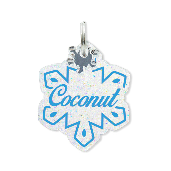 White glitter snowflake dog tag with personalization and free snowflake mini charm.