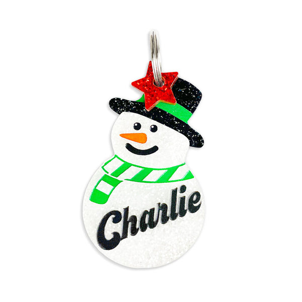 Snowman tag with star mini charm.