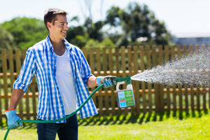 Man spraying fertilizer hose product