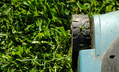 Lawnmower cutting grass close up