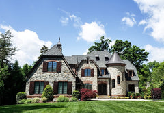 Beautiful large house with a perfect lawn with mow lines