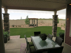 Little porch area with backyard showing great green lawn