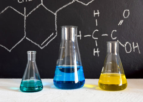 Green Blue and Yellow Chemicals in Beakers