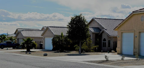 Drought affecting front lawn houses.