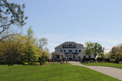 large house with perfect green front lawn mowed and well taken care of