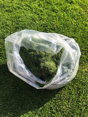 grass clippings in clear plastic bag