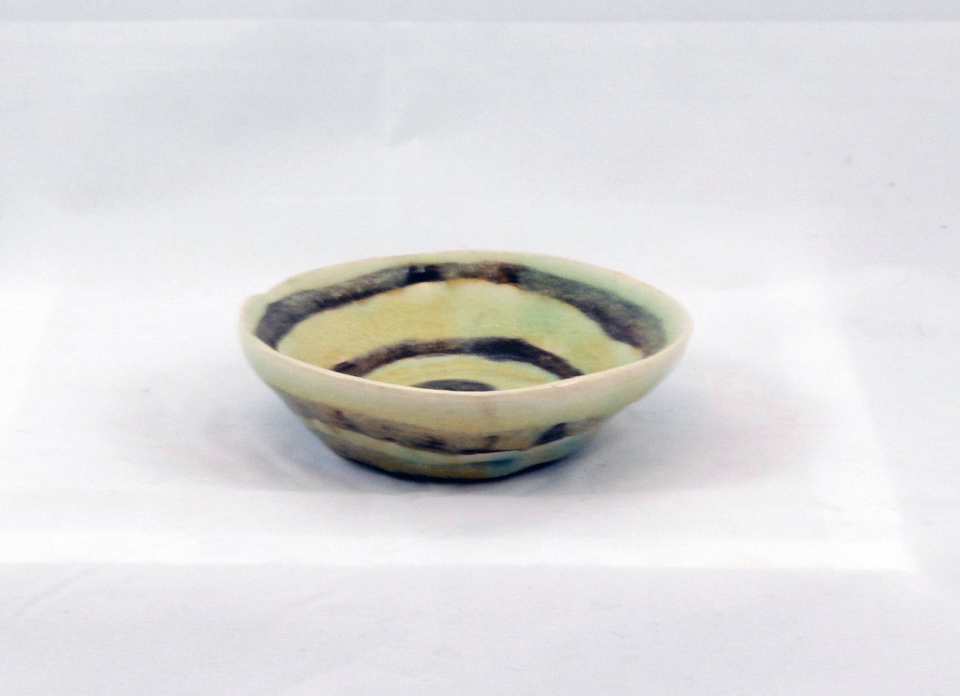 two striped tiny ceramic bowl
