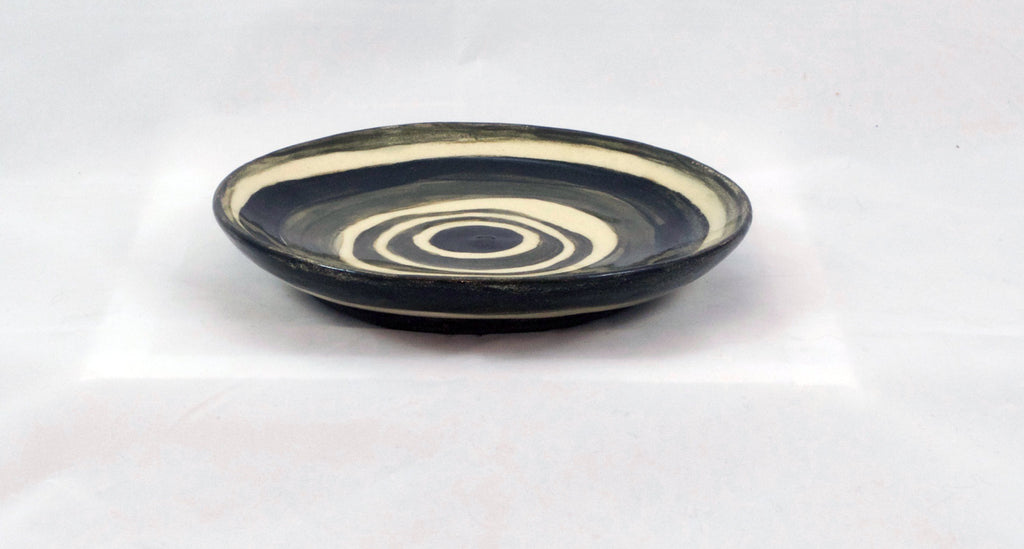 black circles on small ceramic plate
