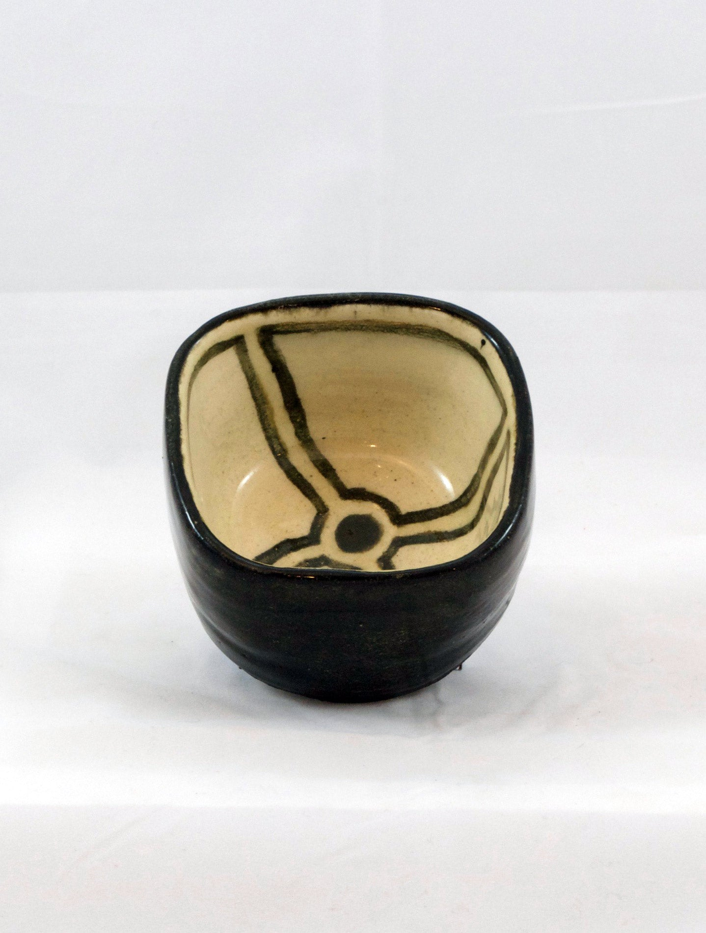 small square ceramic bowl with black stripes