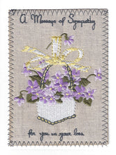 Lavender and Purple Flowers in a White Wicker Basket - S242P