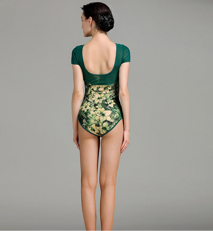 woman wearing floral and green short sleeve bodysuit