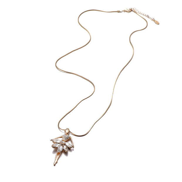 Gold tone ballerina necklace with cubic zirconia