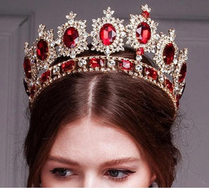 Women wearing faux ruby and rhinestone crown