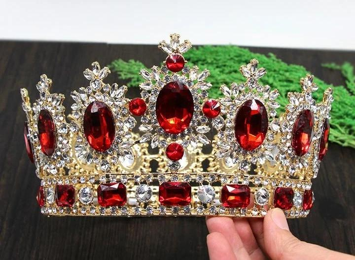 front of faux ruby and rhinestone crown