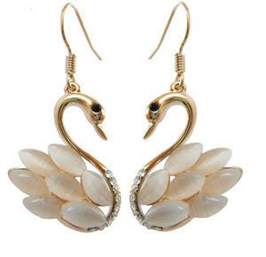white faux opal swan earrings gold tone