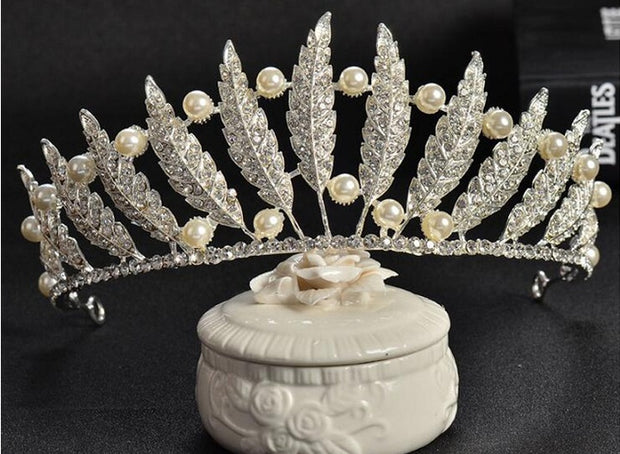 front of feather, pearl and rhinestone tiara for ballet or wedding