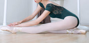 ballet dancer wearing green lace leotard