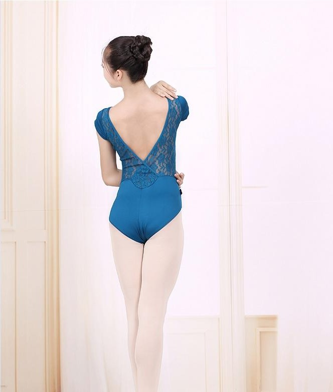 woman wearing turquoise colored lace back leotard