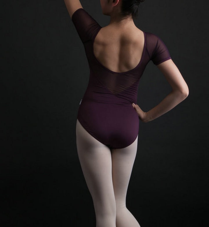 back of woman wearing maroon mesh leotard