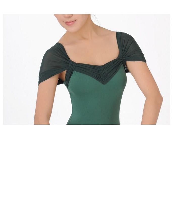 front of woman wearing green off the shoulder leotard